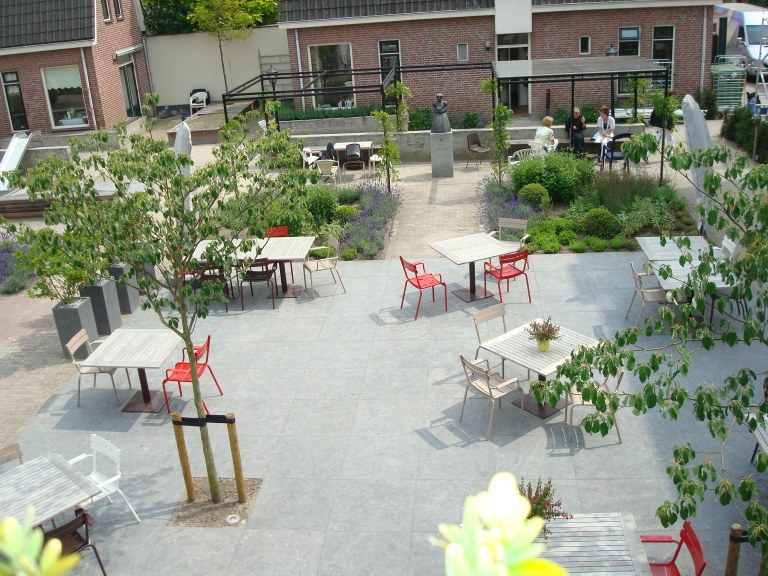 garden with trees and tables
