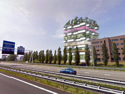 green tall building behind road